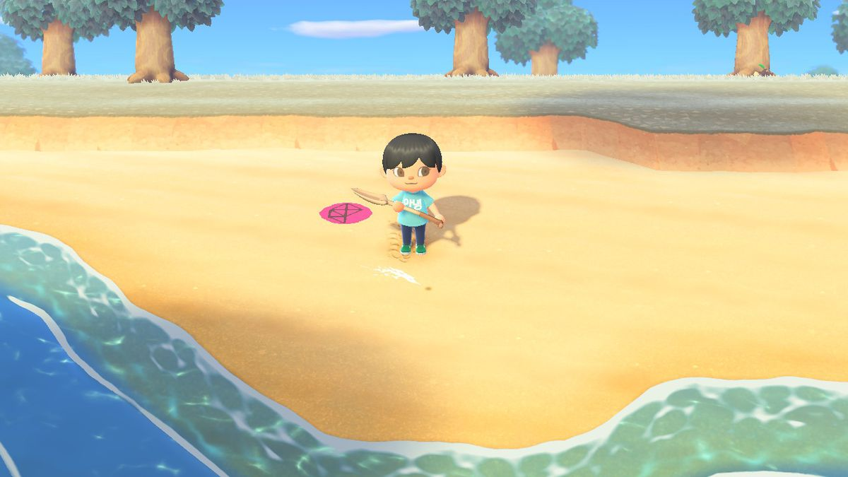 An Animal Crossing character stands on the beach in front of a digging spot with a shovel