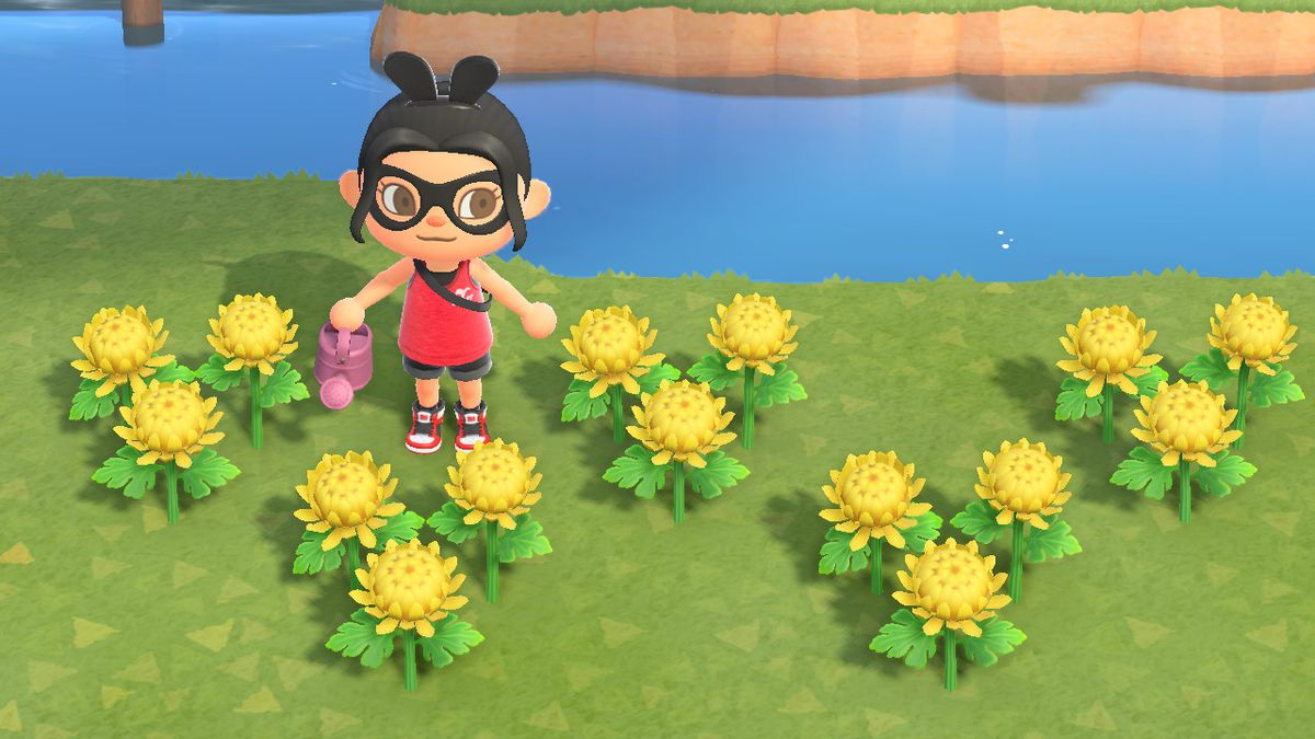 An Animal Crossing character stands around yellow mums