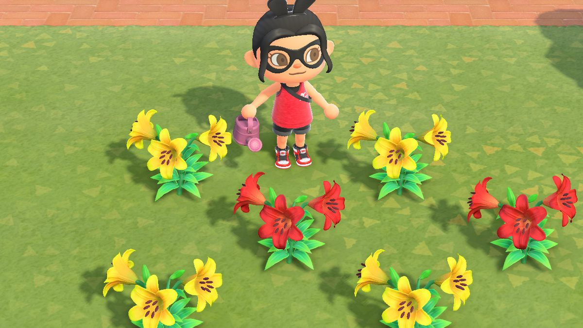 An Animal Crossing character with a pink watering can stands near yellow and red lillies
